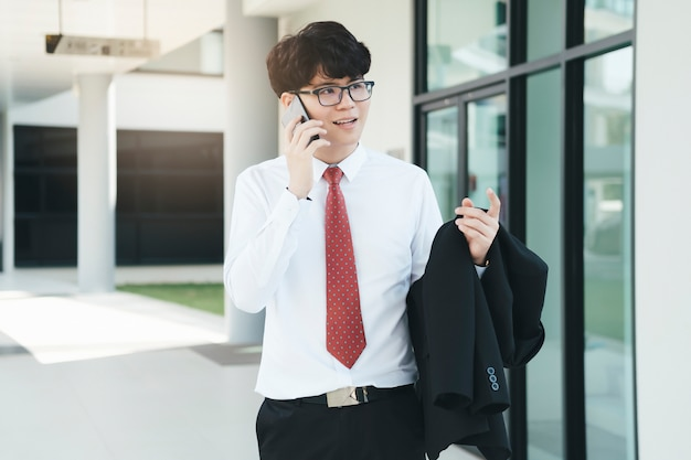 Young businessman speaking over mobile with partners.