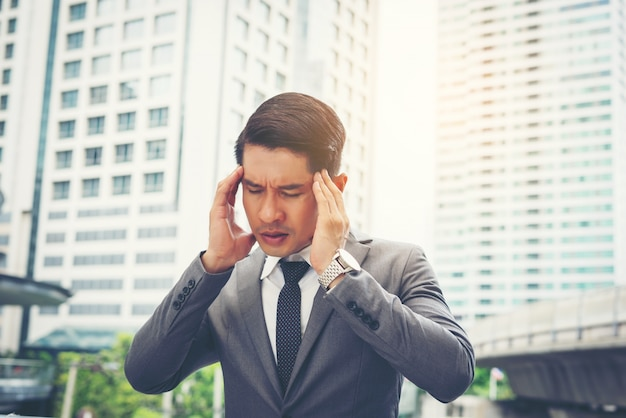 Young businessman stressed while go to work. business people concept.