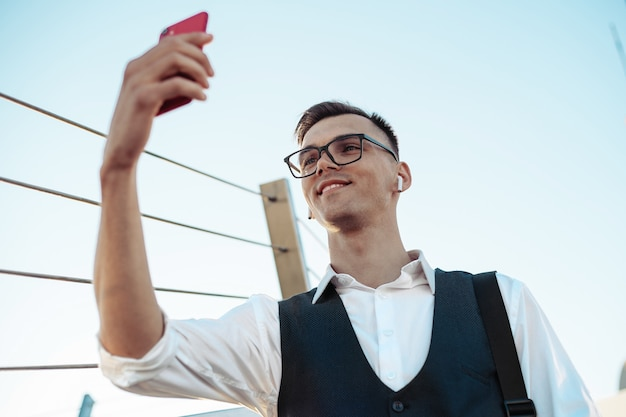 Young businessman taking a selfie on the terrace of a business c