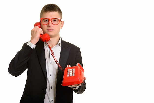 古い電話で話している青年実業家