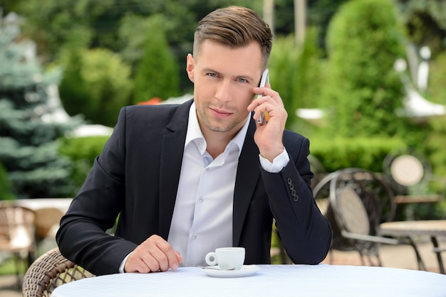 Young businessman talking on phone.