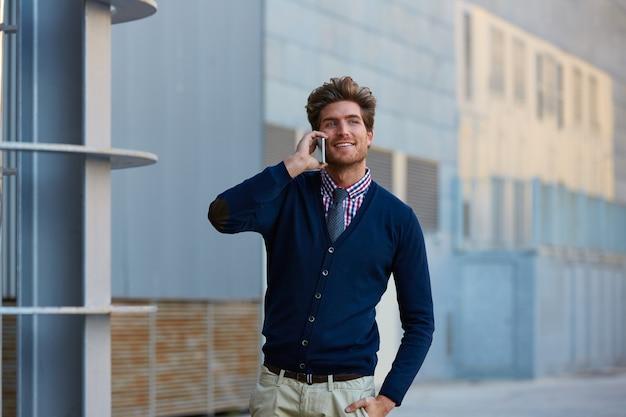 Young businessman talking smartphone walking