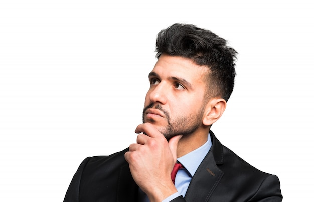 Young businessman in a thoughtful expression