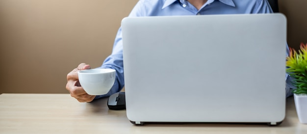 Young businessman using laptop analysis marketing plan