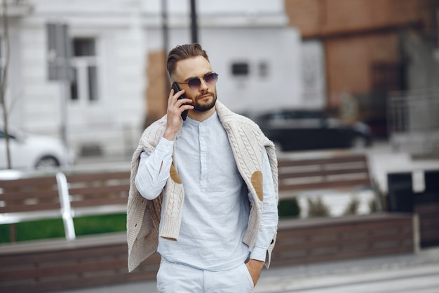 Young businessman walking on the street