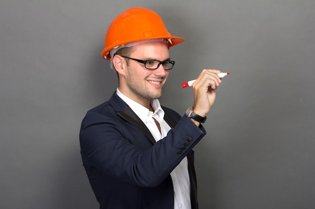 Young businessman wear a safety helmet, writing