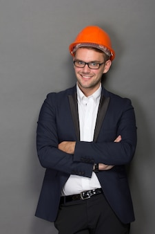 Young businessman wear a safety helmet