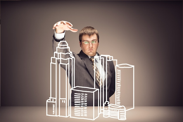 Young businessman with buildings on brown