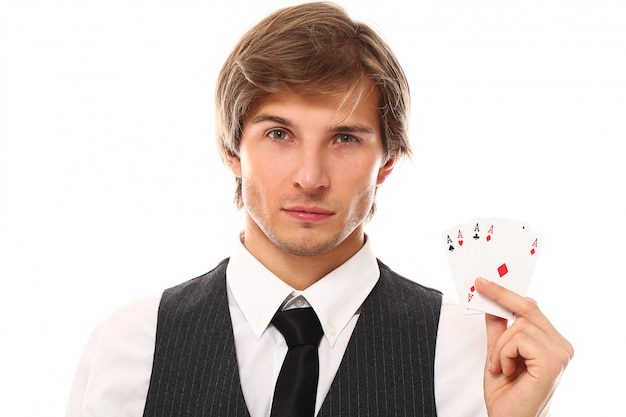 Young businessman with poker cards
