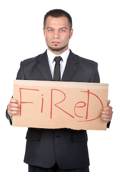 Young businessman with sign fired.