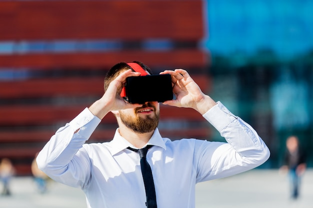 Young businessman with vr glasses