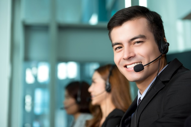 Young businessman working in call center