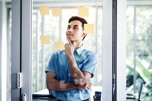 Young businessman working in office meeting room. data planning and project