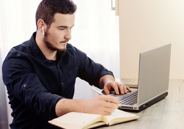 Young businessman working with computer remotely