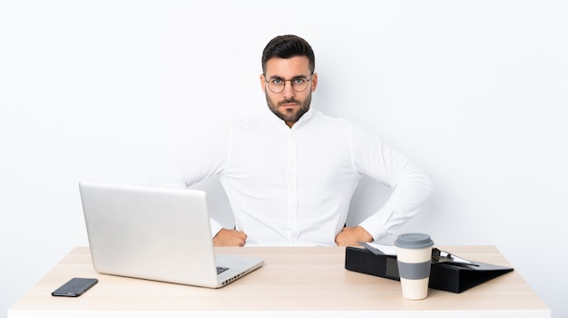 Young businessman in a workplace angry