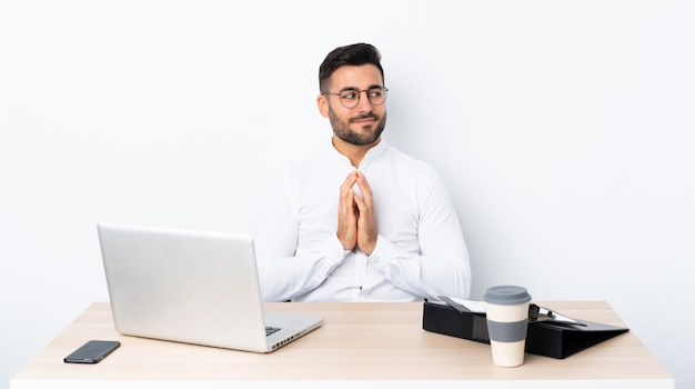 Young businessman in a workplace scheming something