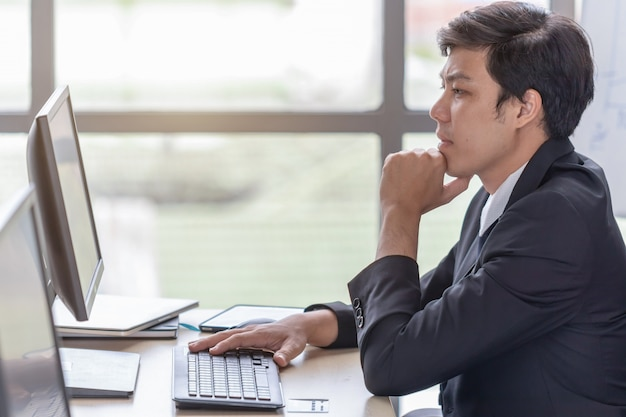 Young businessmen are stressed at the office desk