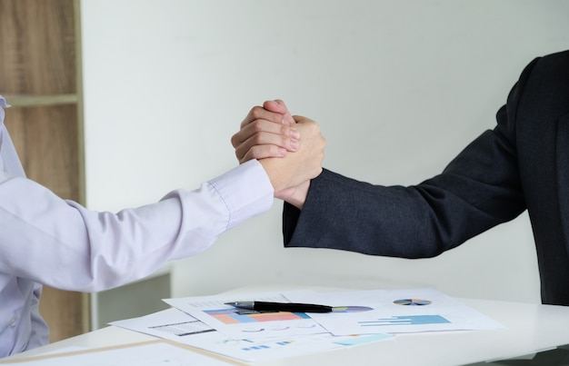 Young businessmen collaborate with partners to increase their business