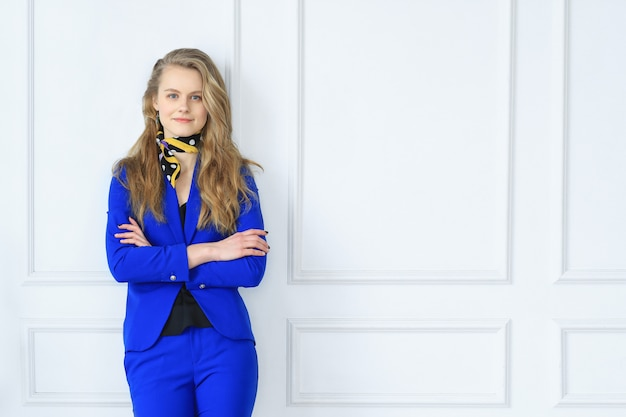 Young businesswoman in blue dress