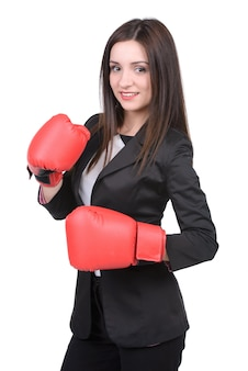 Young businesswoman in boxing concept.