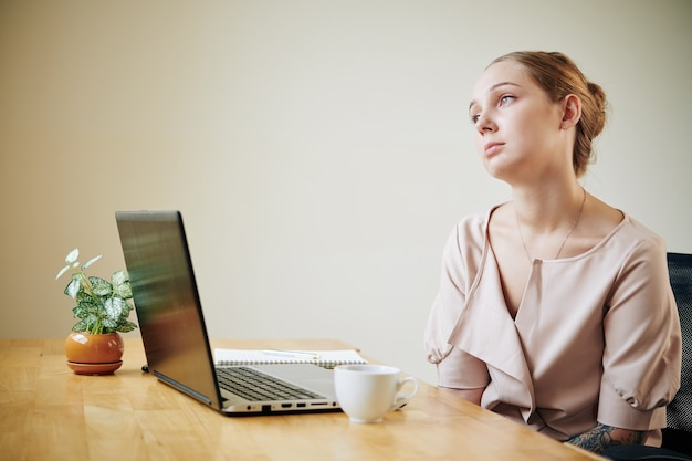 Young businesswoman feeling depressed