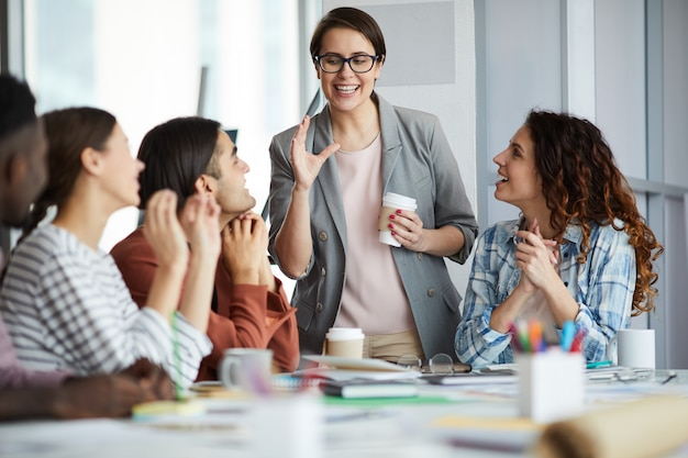 Young businesswoman giving inspirational speech in meeting