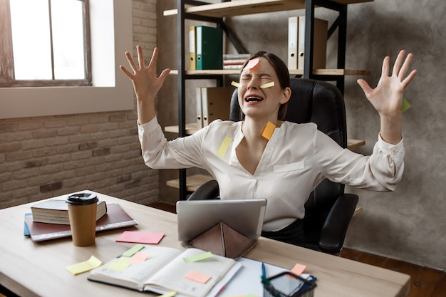 Young businesswoman have panic attack from multitasking