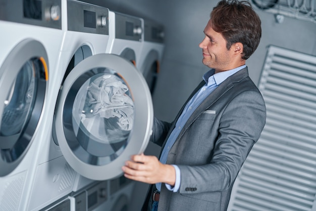 Young businesswoman in laundry room