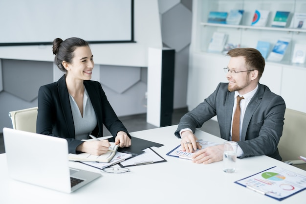 Young businesswoman at meeting with partner