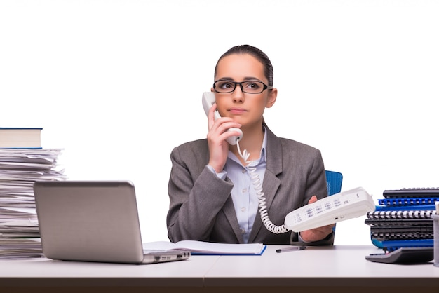 Young businesswoman in office isolated