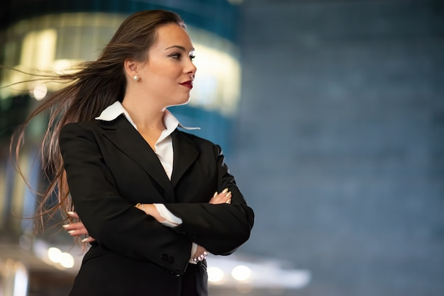 Young businesswoman portrait in a modern city setting at night