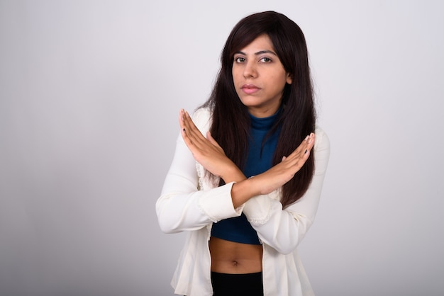 Young businesswoman showing stop hand gesture with both hands