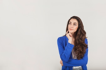 Young businesswoman showing with thoughtful gesture