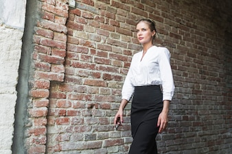 Young businesswoman walking in tunnel