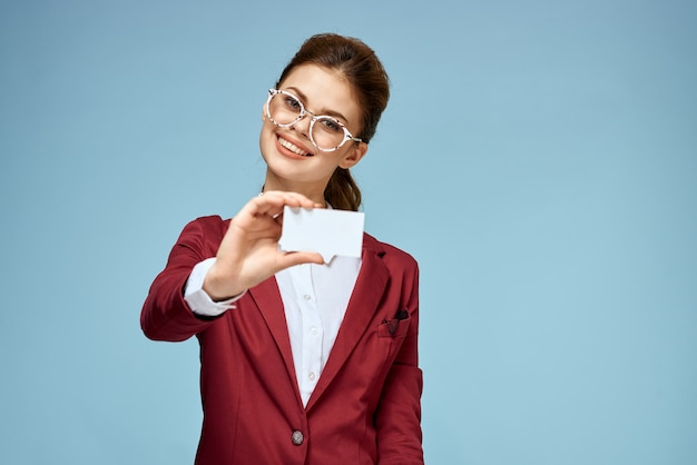 Young businesswoman with business cards in hand, mock up