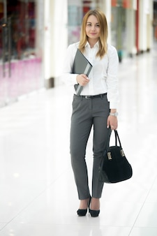 Young businesswoman with document case
