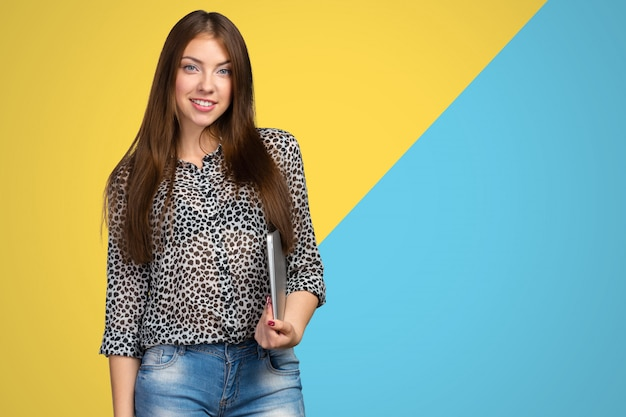 Young businesswoman with laptop and copyspace