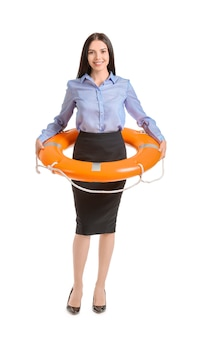 Young businesswoman with lifebuoy on white background