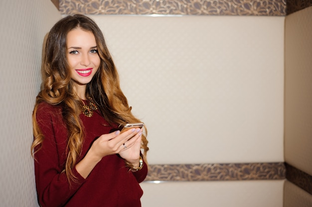 Young businesswoman with mobilephone in the office,