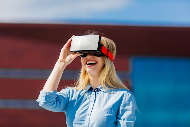 Young businesswoman with vr glasses