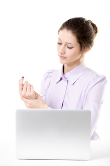Young businesswoman with wrist pain