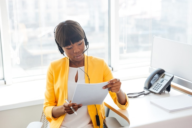 Young businesswoman working in call center Premium Photo