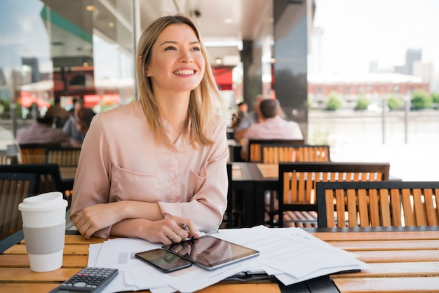 Young businesswoman working at coffee shop.