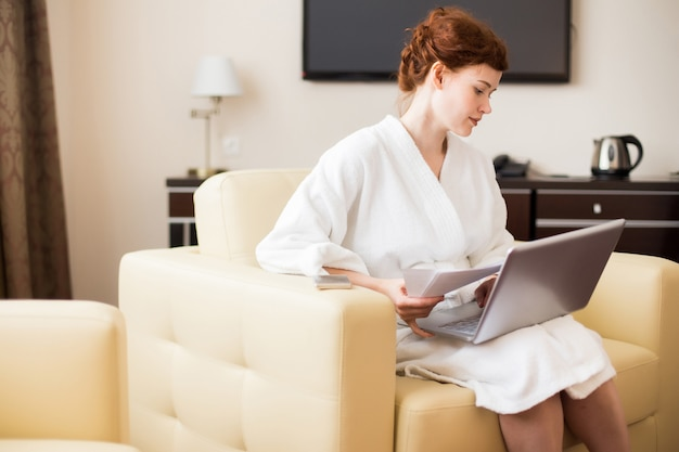 Young businesswoman working in hotel room