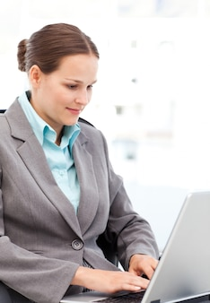 Young businesswoman working on the laptop in her office