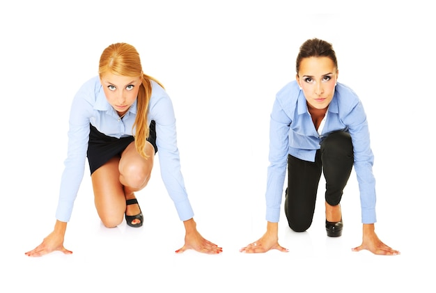 A young businesswomen ready to start a race over white background