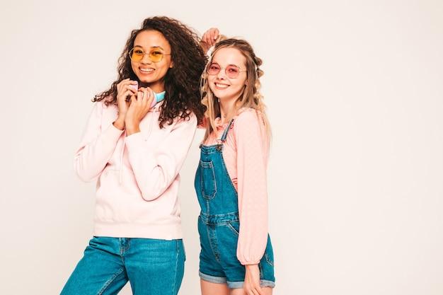 Young carefree women posing in studio