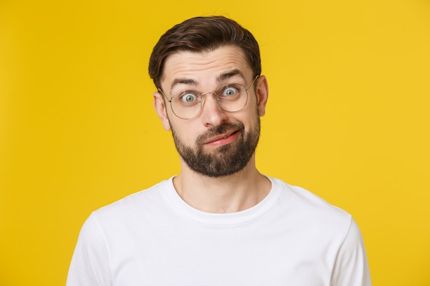 Young casual man portrait isolated on yellow