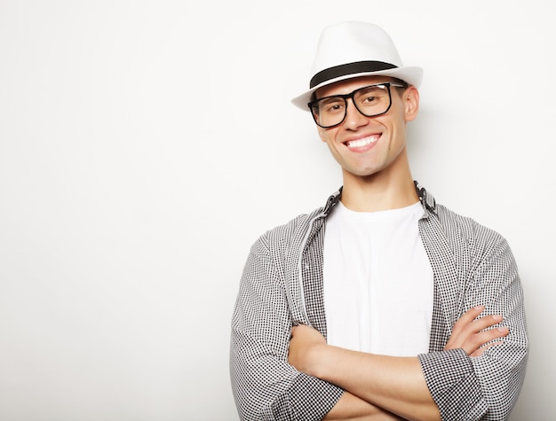 Young casual man with hat