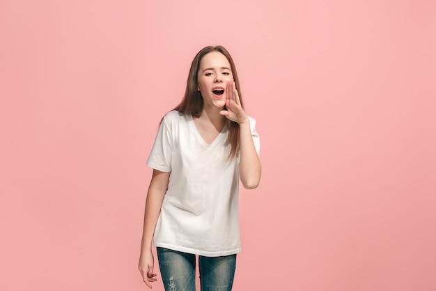 Young casual teen girl shouting at studio